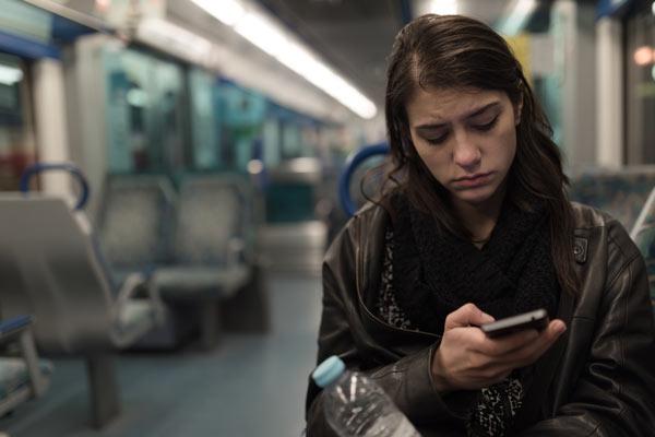 Sad woman on a train
