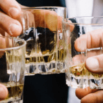 business men sharing drinks