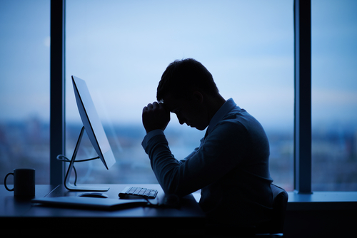 sad man in front of computer