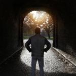 man looking at hallway