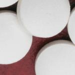 white round pills on red background
