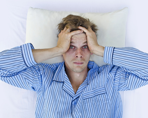 man-with-dark-circles-cannot-sleep-in-bed-